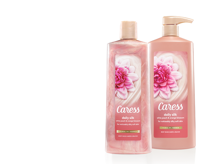 Caress Daily Silk Body 18z and 25.4z bottles (from KV) on a Purple Background